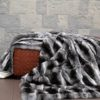 Chinchilla Fur Blanket on Belvoir Woven leather Ottoman