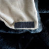 Fur and Cashmere fabric detail with hand stitched leather label