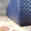 Braided leather detail and detail of matching leather plinth